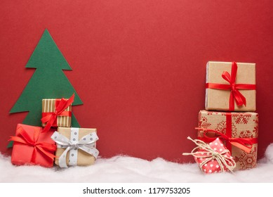 pile of christmas gifts red background with copyspace