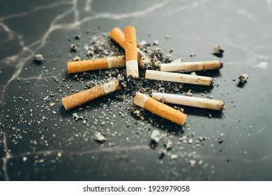 Pile of cigarette butts on the floor, health problems from smoking, abstinence from smoking, no smoking campaign ideas.