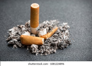 pile of cigarettes smoked in a pile of ashes