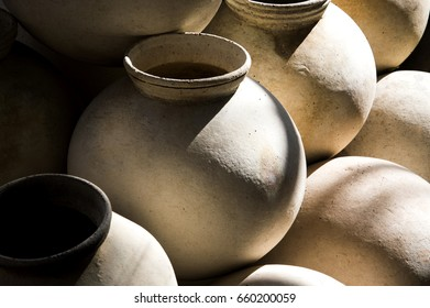 the pile of clay pot with shadow casting on it