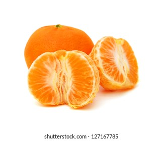 A pile of Clementine Mandarin Oranges. Horizontal format over a white background with reflection.