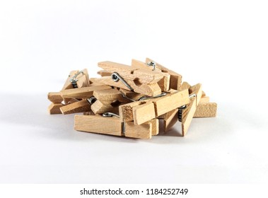 Pile of cloth clips on white background