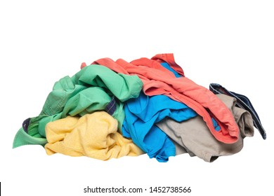 Pile of clothes isolated. Stack of colorful dirty clothes ready for the laundry isolated on a white background.