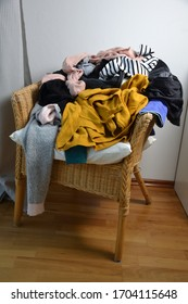 Pile of clothes on a chair