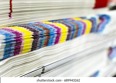 Pile of cmyk color bar newspapers