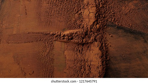 pile cocoa powder isolated on black background, top view