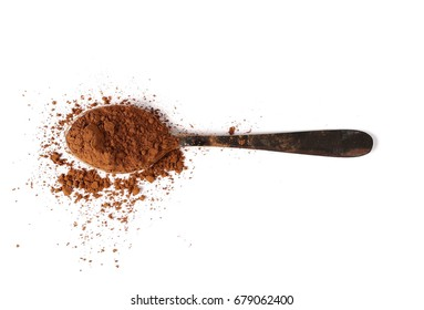 pile cocoa powder with metal spoon isolated on white background