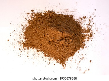 Pile of cocoa powder on white background, view from top