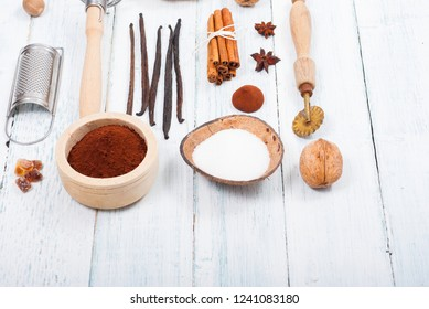 pile of cocoa powder, sugar and dessert ingredients, kitchen utensils on old white wooden