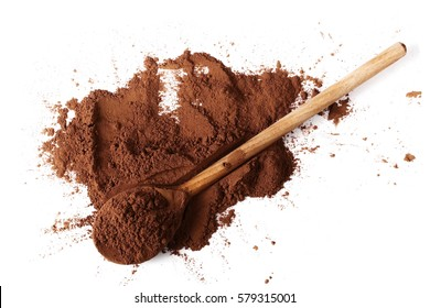 pile cocoa powder and wooden spoon isolated on white background