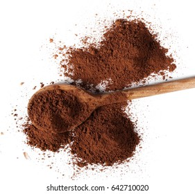 pile cocoa powder and wooden spoon isolated on white background, top view