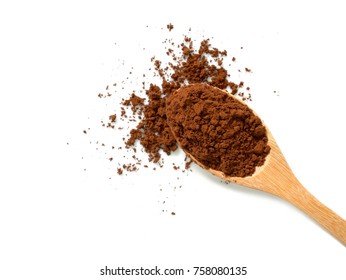 Pile of cocoa powder in wooden spoon isolated on white background. Top view.