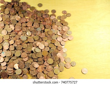 Pile of coins of euro cents on wooden background