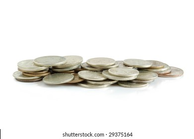 A pile of coins isolated on white background