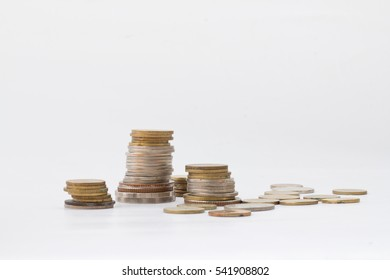 A pile of coins on isolated white background