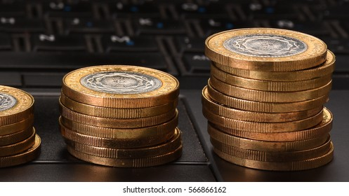 Pile of Coins on a Laptop