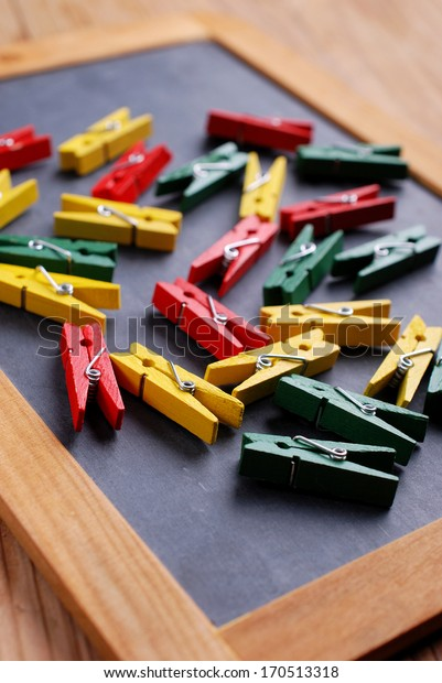 pile of colored pegs on black chalkboard