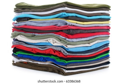 pile of colored shirts isolated on white background