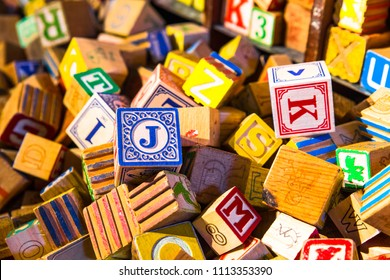 Pile of colorful children's alphabet wooden block toys