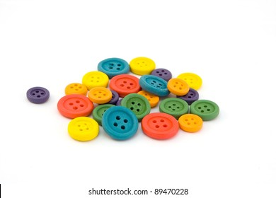 Pile of colorful buttons isolated on white