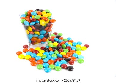 Pile of colorful candy drops isolated on white
