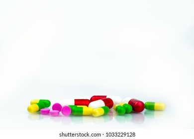 Pile of colorful capsule and tablets pills on white background with copy space for text. Pharmaceutical industry. Pharmacy department in the hospital concept. Drug store concept. Drug interactions.
