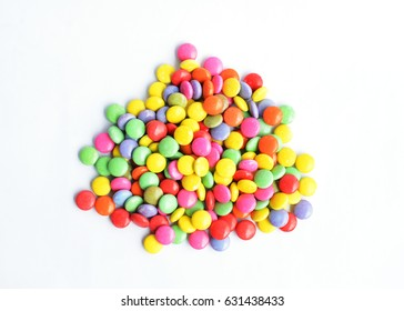 a pile of colorful chocolate coated candy Isolated on white backgrounds above