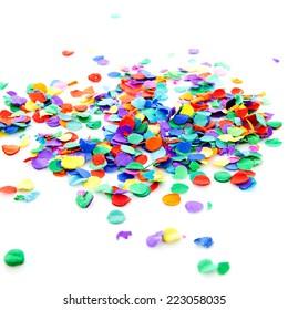 pile of colorful confetti over white background
