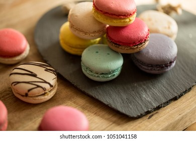 pile of colorful macarons/ sunlight