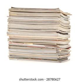 pile of colorful magazines isolated on white background