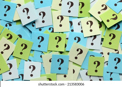 Pile of colorful paper notes with question marks. Closeup.