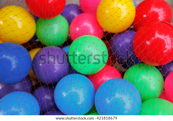 A pile of colorful plastic balls