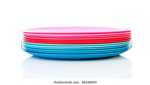 Pile of colorful plastic plates over white background