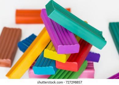 Pile of colorful plasticine sticks on light background. Selective focus