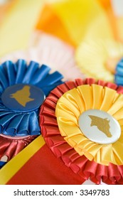 A pile of colorful ribbons won at horse shows.