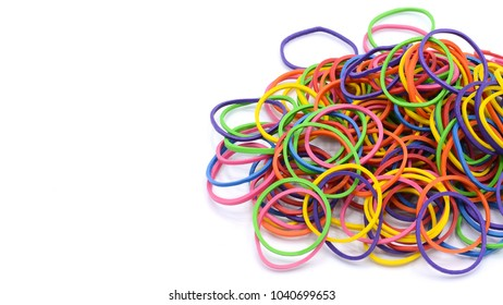Pile of colorful rubber bands isolated on white background