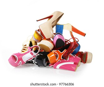 pile of colorful shoes on white background