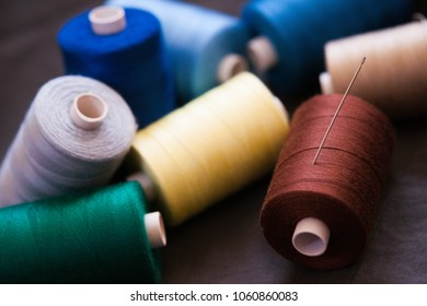 Pile of colorful spools of thread
