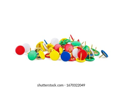 Pile of colorful thumbtacks on white background.