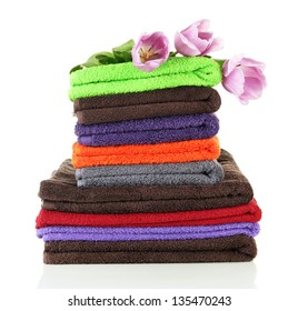 Pile of colorful towels, isolated on white