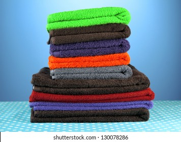 Pile of colorful towels, on blue background