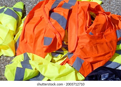Pile of colorful transportation industry working uniforms sold on market