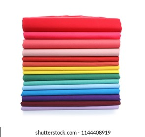 Pile of colorful t-shirts on white background