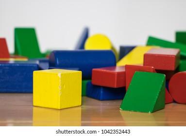 Pile of colorful wood blocks on hardwood floor
