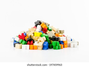 Pile of colorful wooden organic shape piece  on white background