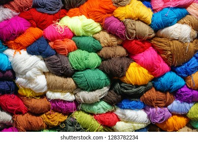 Pile of colorful yarn for sale at the market in Cotacachi, Ecuador