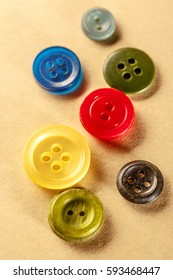 Pile of colourful buttons on paper closeup