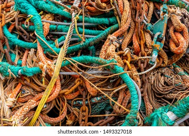 Pile of commercial fishing net with cords, net, rope chain and cables
