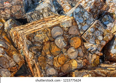 Pile of compacted cubes of rusting metal cans for salvage
