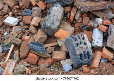 A pile of construction debris is broken brick and concrete.
